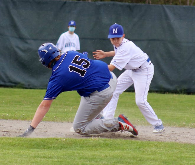Murdock's Steve Gauthier (15) slides safely into second with a double for the Blue Devils as Narragansett second baseman Travis Cohn applies a late tag during Monday's game in Baldwinville.