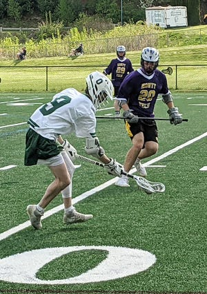 Oakmont's Jake Pelkey scoops up a ground ball in front of Monty Tech's Kristian Scrafin (20) during a May 18, 2021 game in Ashburnham. The Spartans earned the third seed in next week's Central Mass. Division 2 Tournament.