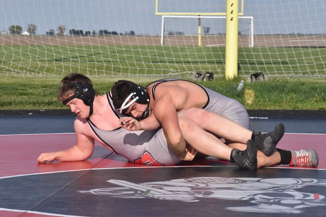 Orion's Josh Fair, right, takes teammate Phillip Dochterman to the mat in an exhibition on Thursday, May 13, at the west end of Charger Field. Because of COVID-19 restrictions, wrestling went on the IHSA calendar as a summer sport. Orion made the most of the scheduling by hosting Monmouth-Roseville for an outdoor meet. After the varsity bouts ended, wrestlers had exhibition matches.