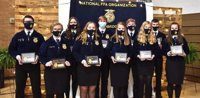 The Blue and Gold Award is one of the highest presented in FFA programs. On Saturday, April 24, Cambridge FFA advisor Trent Taber presented Blue and Gold awards to 10 students for their contributions to the program. In front from left are Taylor Pace, Annie Johnson, Miranda Reed, Brooklyn Humphrey and Kendra Downing, and in back, Cameron Pace, Madison Casteel, Jack Jewett, Taylor Snook and Rodney Beam.