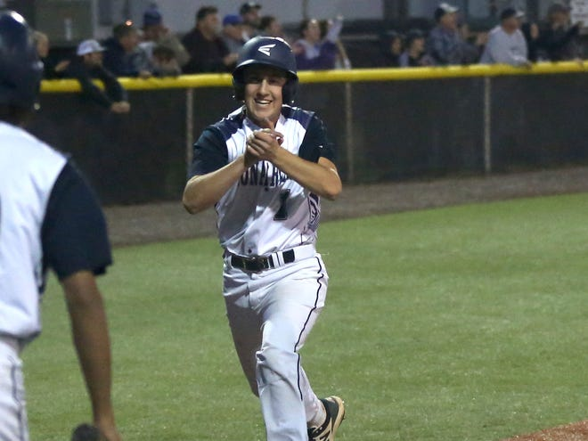 TMP's Drew Werth scores in the bottom of the seventh inning on a game-tying double from Nick Herrman.