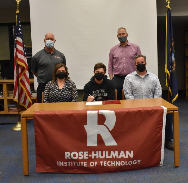 Lucas Czarnecki (middle) signs to play baseball with Rose-Hulman.