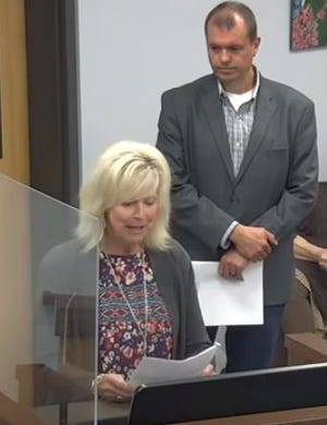Reno County United Way Executive Director Lisa Gleason addresses the Hutchinson City Council Tuesday on a proposed process for gathering public input on best how to spend millions in federal American Rescue Plan dollars coming to the city and county, as Hutch Rec Director Tony Finlay looks on.