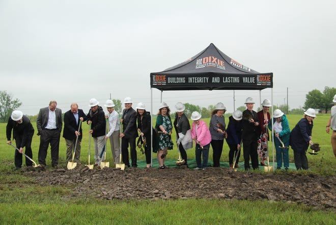 Staff members with Mark Twain Behavioral Health put shovels to dirt Tuesday as part of a groundbreaking ceremony for the company's new Kirksville facility.
