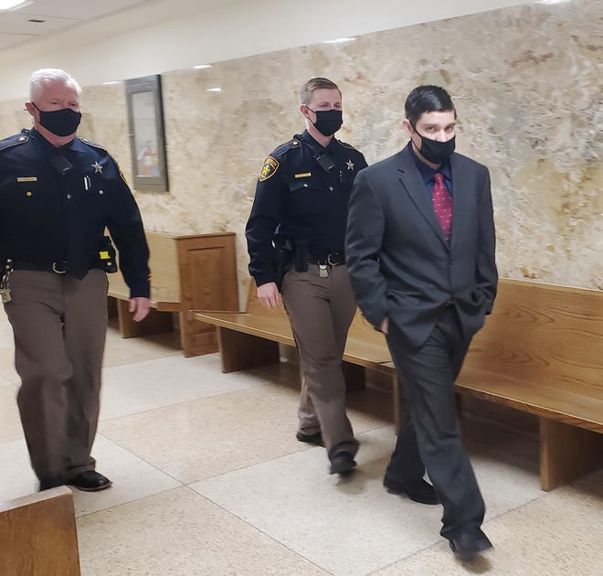 Chance Copeland, right, is escorted out of the 364th District Courtroom where he stands trail for murder in connection with the June 2019 shooting death of Cassie Oden.