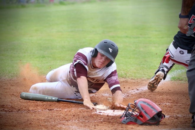Merryville's Causey Owen slides in safely across home during a game earlier this season. Owen was named the District 4-1A Most Valuable Player this season after batting .576 with 19 RBIs.