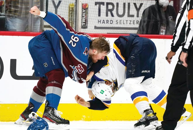 Colorado Avalanche left wing Gabriel Landeskog, left, fights with St. Louis Blues center Brayden Schenn in the first period of Game 1 of an NHL hockey Stanley Cup first-round playoff series Monday, May 17, 2021, in Denver.