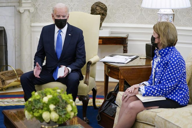 In this May 13, 2021, file photo, Sen. Shelley Moore Capito, R-W.Va., right, listens as President Joe Biden speaks during a meeting with Republican Senators in the Oval Office of the White House in Washington. The two senators from West Virginia are playing central roles in Biden's infrastructure plans. Democrat Joe Manchin is a crucial 50th vote for his party on Biden's proposals.