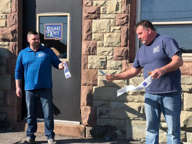 Nate Crane and Paul Newhook, pictured at the Square Knot Brewing grand opening in February 2020, are teaming up with Clarky's Twisted Sauce to buy the Three Huskies Brewing spot in Canandaigua.