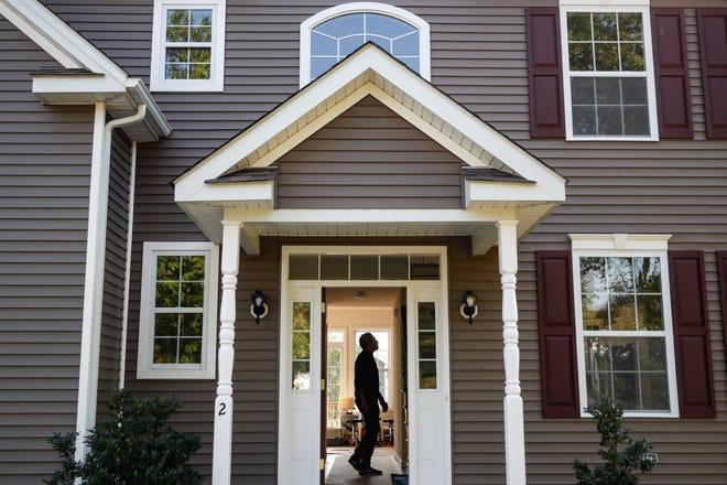 A homeowner tours his new home in Washingtonville, New York. [AP File Photo/John Minchillo]