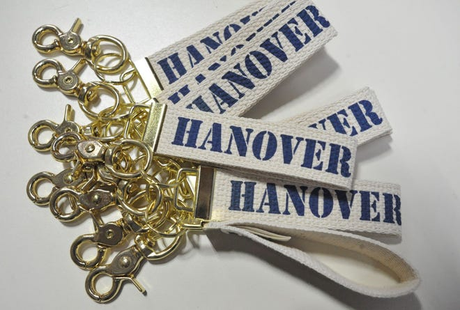Custom-made keychains are ready for shipping to Hanover at Rustic Marlin in Hanover, Wednesday, May 12, 2021.