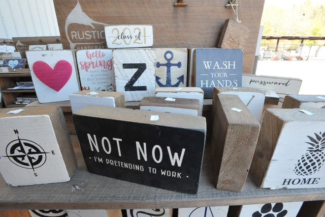 Various signs are offered in the Marlin Market at the Rustic Marlin in Hanover, Wednesday, May 12, 2021.