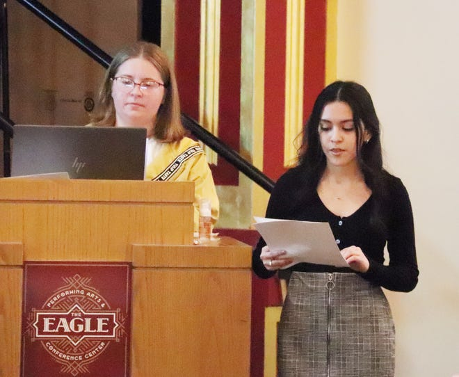 Pontiac Township High School students Ariel Nichols, left, and Madelyn Lee make a presentation on trash to the Pontiac City Council at its meeting Monday.