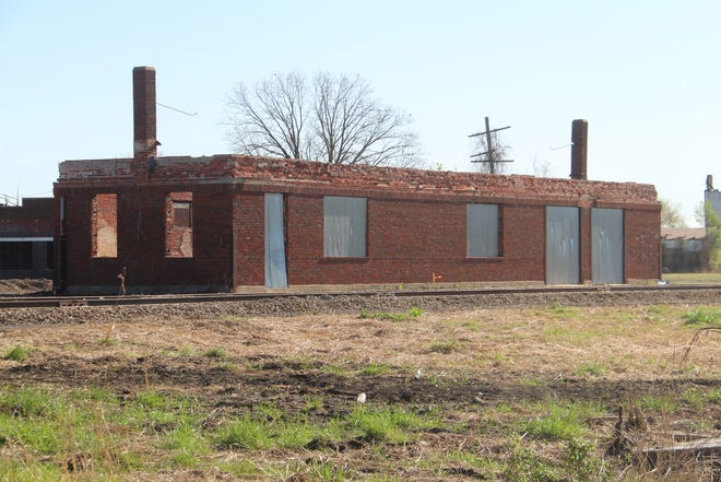 """This is an image of the ruin of the freight building on the old Midland Valley Railroad depot site in Pawhuska, as it appeared after movie set workers cleaned up the lot, located south of Allen Brothers Feed & Supply on 5th Street. Set development workers built a wooden frame for a """"train station"""" around it."""