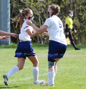 Jordan (right) and Taylor Noble had plenty of reasons to celebrate with each other Monday, with seven goals between them.