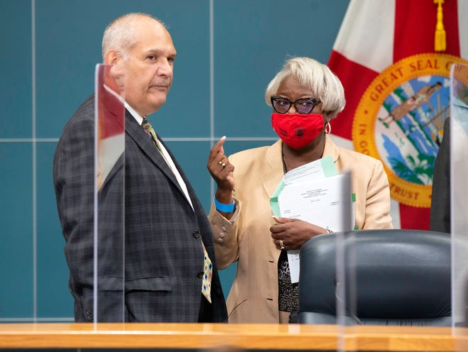 Palm Beach County Vice Mayor Robert Weinroth talks with Verdenia C. Baker, county administrator, before the County Commission meeting in West Palm Beach Tuesday, May 18, 2021.