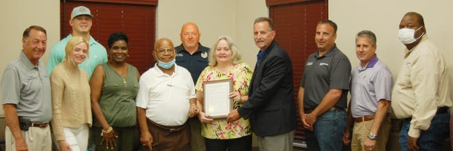 Shown in the photo of the proclamation presentation in honor of late Plaquemine City Police Captain Mike Little are, from left, Selectman Lin Rivet, Taylor Duncan (Mike's granddaughter) and behind her Luke Devillier, Selectwoman Wanda Jones, Selectman Oscar Mellion, Police Chief Kenny Payne, Noreen Little (Mike's wife), Mayor Ed Reeves, Jr., and Selectmen Shannon Courtade, Tommy LeBlanc and Jimmie Randle.