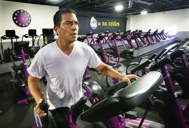 Nicholas Marsella works out at Planet Fitness in Warwick. The gym has changed its mask policy for members, offering an unencumbered option to those who are fully vaccinated.