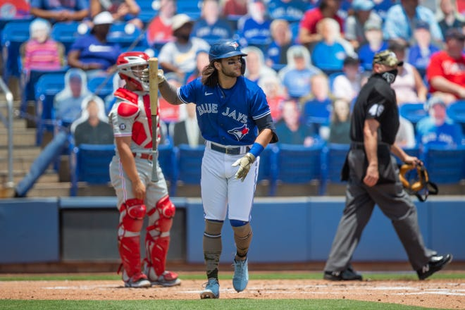 May 16, 2021; Dunedin, Florida, USA; Toronto Blue Jays shortstop Bo Bichette (11) watches his homerun leave the field during the first inning of a game against the Philadelphia Phillies at TD Ballpark. Mandatory Credit: Mary Holt-USA TODAY Sports