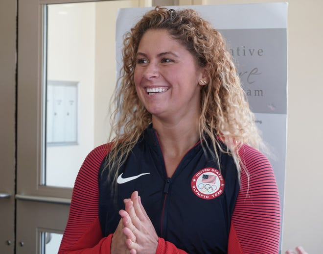 Elizabeth Beisel's fundraising swim from Point Judith to Block Island has been postponed because of bad weather.