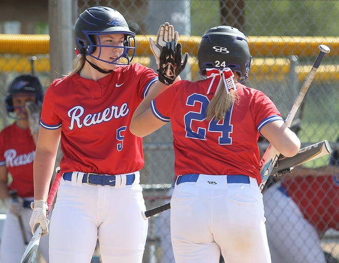 Revere's Shannon Appel, left, high-fives teammate Jeanne Hujer after scoring in the first inning against Coventry during their Division II district semifinal game at Willig Park on Tuesday. Revere won 3-0. [Canton Repository]