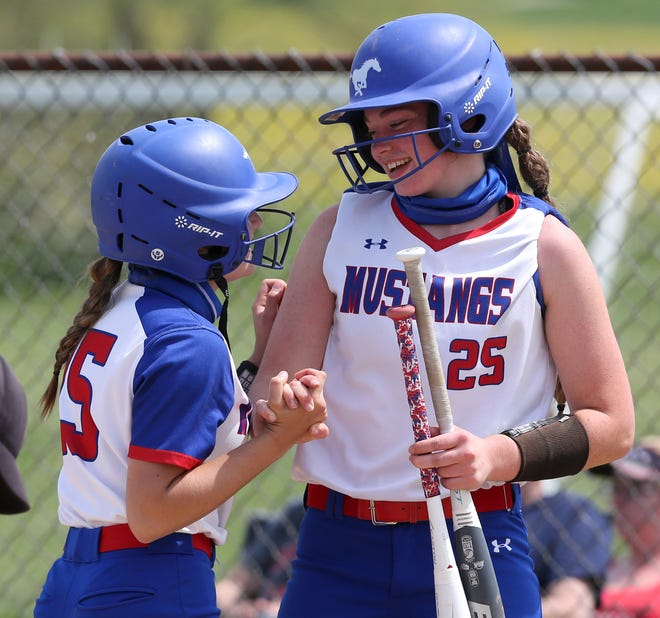 Lillian Butcher (15) of Tuslaw celebrates her home run with Meridith Rankl (25) during their Division III district semifinal game against Manchester at Norwayne on Tuesday, May 18, 2021. The blast accounted for the winning margin.