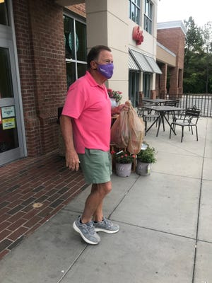 Dan James picks up groceries at Ingles May 18. James said he'll continue to wear his mask to protect others despite being fully vaccinated.