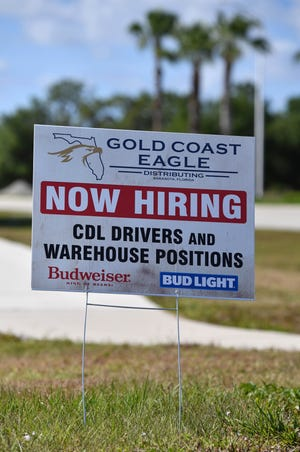 """A """"Now Hiring"""" sign on Lakewood Ranch Boulevard in front of Gold Coast Eagle Distributing, where the Suncoast Chapter of the Florida Restaurant & Lodging Association held a networking event Tuesday."""