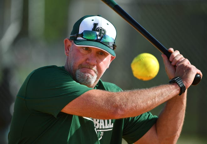 Lakewood Ranch High softball coach TJ Goelz hits to his players during a fielding drill during practice on March 31.