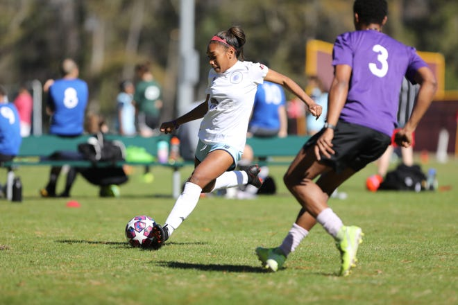The Savannah Spirit's Kayla Jackson beats her defender as she makes an attempt to score during a 6 vs. 6 soccer tournament on Jan. 23 at Benedictine Military School.