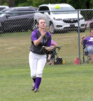 Three Rivers left fielder Macy Ivins makes a running catch for an out against Sturgis on Monday afternoon.