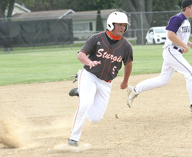 Dakota Luce of Sturgis hits the bag and heads for home against Three Rivers on Monday afternoon.