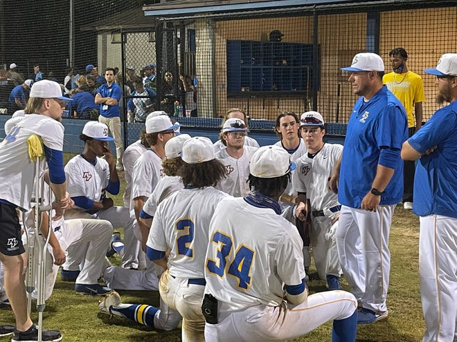 Newberry High School baseball head coach Mike Spina addresses his team after defeating Williston May 11 to advance to the 1A state semifinals in Fort Myers.