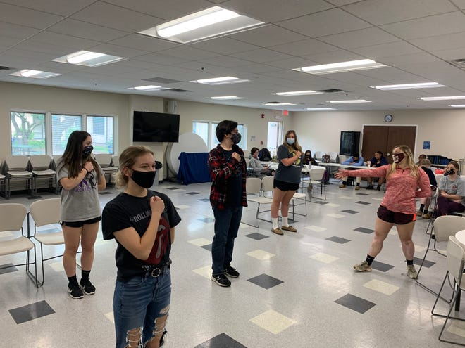 """From left, Molly Bertone, Emma Klinko, Jonathan Bryson, Madeline Boothe and MacKenzie Kotch rehearse for St. Maria Goretti Players' production of the musical """"Little Women."""""""
