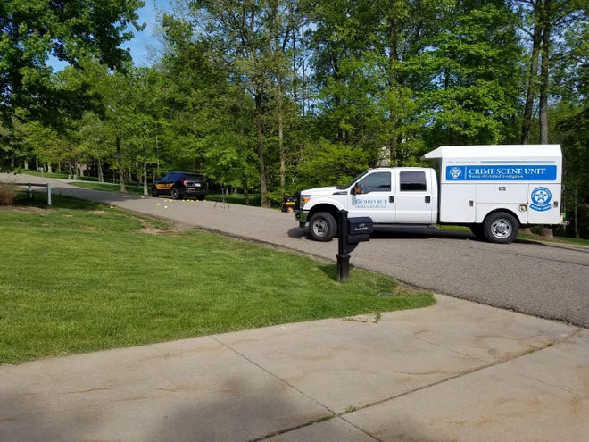 A crime scene unit from the Ohio Bureau of Criminal Identification and Investigation blocks Russell Drive NW in Lawrence Township on Tuesday afternoon. A male resident reportedly shot at a deputy who went to the home to question a suspect about a suspicious letter.