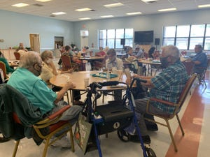 Clients play bingo at the Bay County Council on Aging's Senior Center off Frankford Avenue in Panama City.