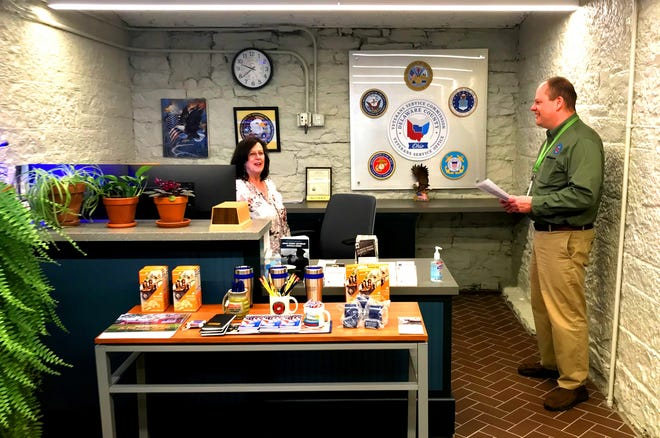 Brian Galligher, director of the Delaware County Veterans Service office, chats with Karen Kish, administrative assistant, in the office's new location in the basement of the county's Historic Courthouse, 91 N. Sandusky St.
