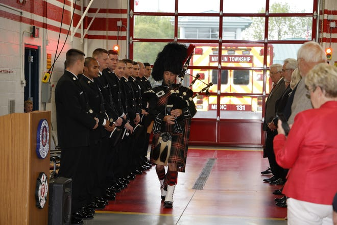 Nine Mifflin Township firefighters were sworn in May 5 at Station 131, 475 Rocky Fork Blvd. in Gahanna. The firefighters include (from left) Thomas Coyne, Devon Lee, Nicholas Leidheiser, Nicholas Marcum, Scott Meyer, Jacob Naro, Henry Oberling, Gregory Parks and Marcus Rieneke. Playing the bagpipes is Mifflin Township firefighter Jordan Irwin.