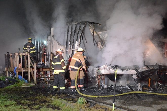 Firefighters battle fire at Avenue A Mobile Home Park in Springfield Tuesday morning.  (Trace Christenson/The Enquirer)