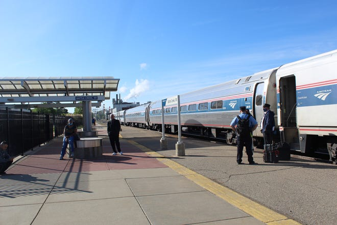 Passengers and conductors prepare to board the Amtrak train from Battle Creek to Chicago on Tuesday, May 18, 2021. Amtrak is increasing speeds on the line between Kalamazoo and Albion.