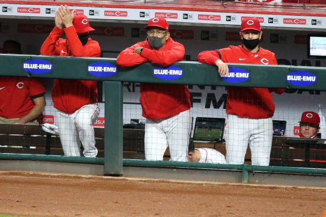 Since the Reds reached Major League Baseball's 85% vaccinated rate, managers, coaches and players won't be required to wear masks in the dugout.