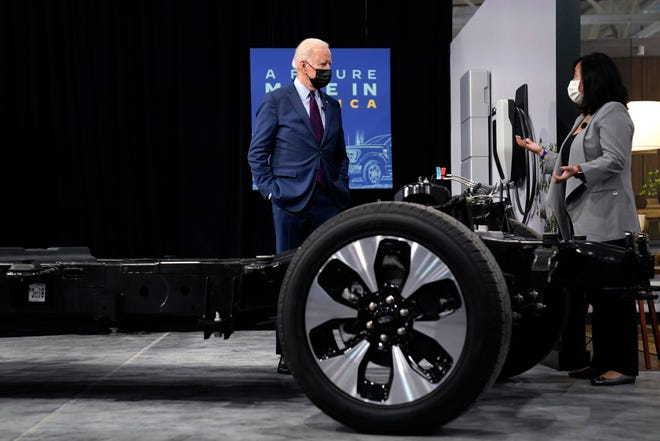 President Joe Biden listens during a tour of the Ford Rouge EV Center on May 18, 2021, in Dearborn. He is talking to Linda Zhang, chief engineer of the all-electric Ford F-150 Lightning.