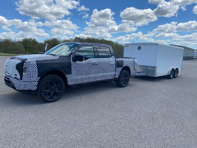 2022 Ford F-150 Lightning electric pickup towing 6,000-lb. trailer at Ford proving ground in Romeo, Mich.