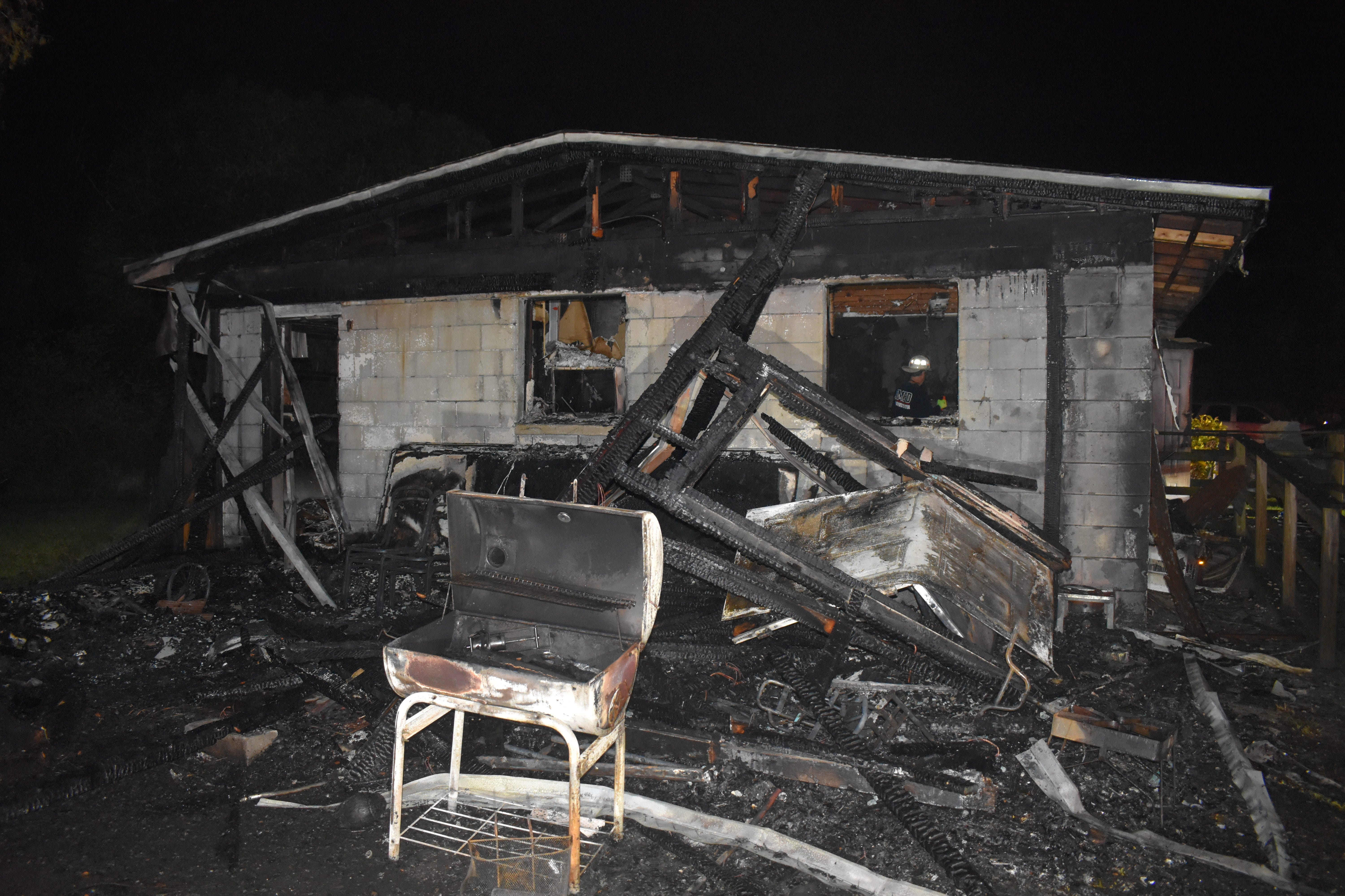 Harlem Heights fire destroys home; firefighters help save belongings dear to residents 3
