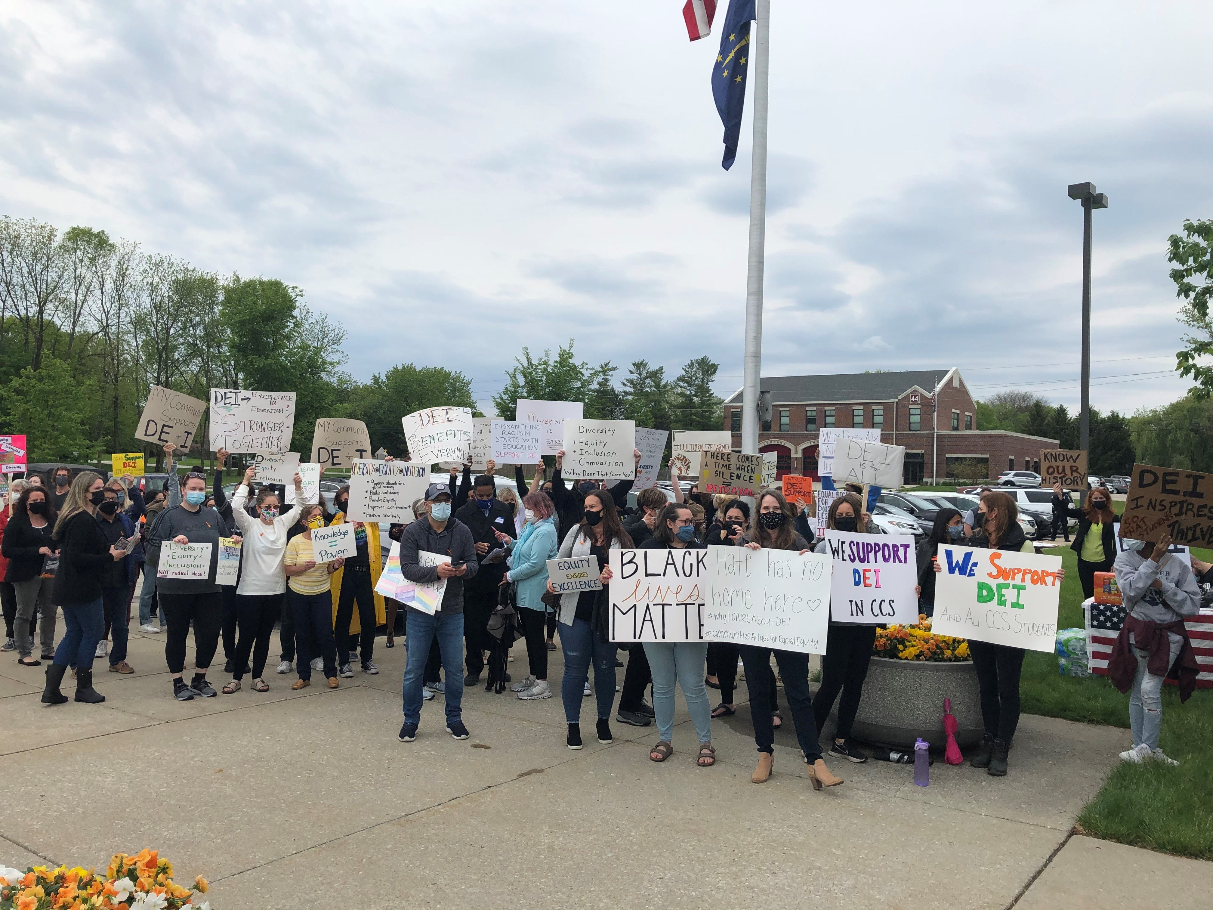 A crowd starts to gather ahead of the Carmel Clay School Board meeting on May 17, 2021. This group carried signs to support DEI work in the district.