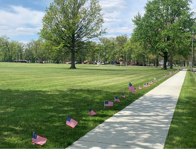 OhioHealth Marion General's new public walking path is lined with flags to honor veterans through Memorial Day.