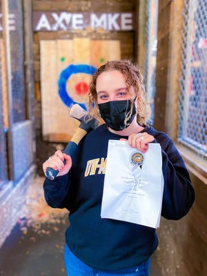 At AXE MKE, recent gradscan use their textbooks, schoolwork or thesis papers as targets for ax throwing on May 23 and 30.