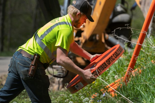 Workers for Eau Claire-based Underground Systems Inc. bury fiber-optic cable  May 12 in Hager City. The project was partially funded by a $444,211 state Public Service Commission grant to Hager Telephone Co.