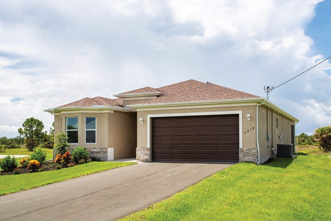 The Fiesta, a spacious a three-bedroom plus den two-bath home, one of the popular designs buyers selected at Arrowhead Reserve in Immokalee.