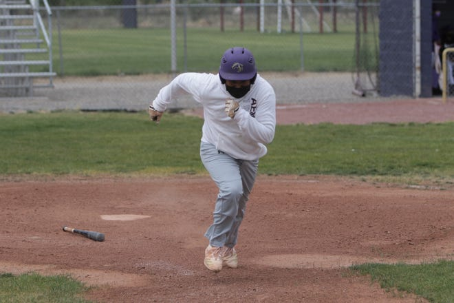 Ethan Yazzie, seen here running down the first base line during Kirtland Central's practice on Monday, May 17, 2021, is now batting a team-high .556 with one home run, 15 RBIs and 16 runs scored, and his on-base percentage is up to .667. All six of his stolen bases came in just the last three games alone.